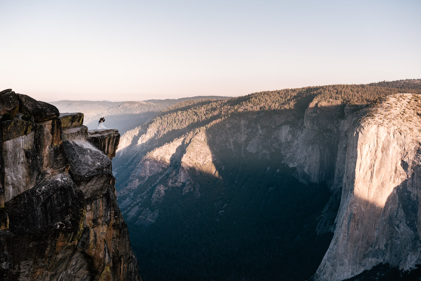 Dramatic photograph of a couple kissing at Taft Point.