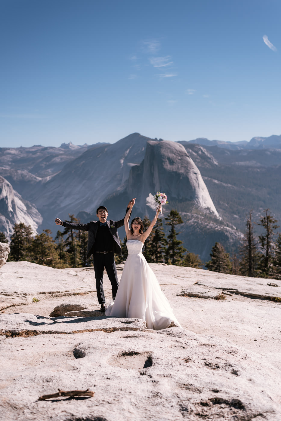 Newly married couple celebrates their marriage a top Sentinel Dome.