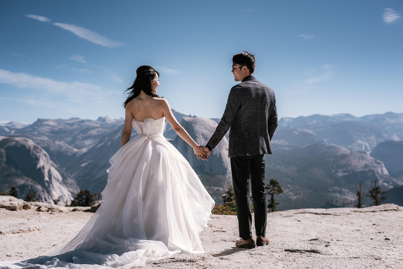 Two love birds hold hands and smile at each other during their Sentinel Dome elopement.