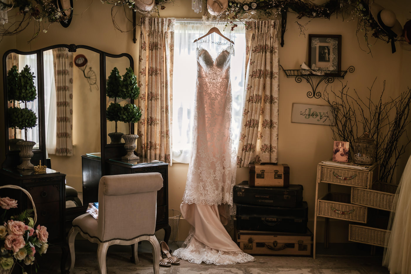 Gorgeous wedding dress hangs in the window of the bridal suite at The Homestead.