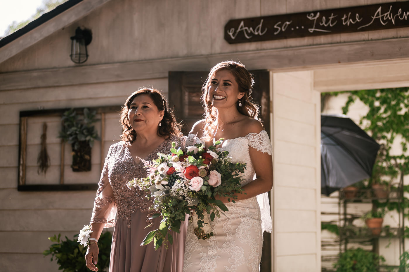 Bride makes her entrance with her mother and walks down the aisle.
