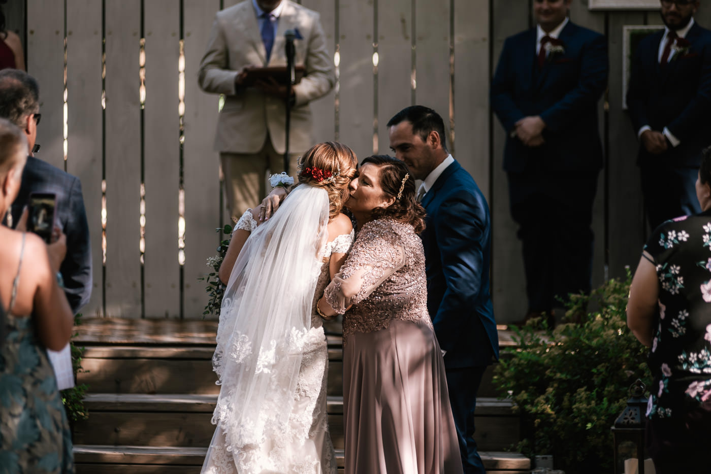 Emotional moment between a mother and daughter at this rustic wedding ceremony in Oak Glen.