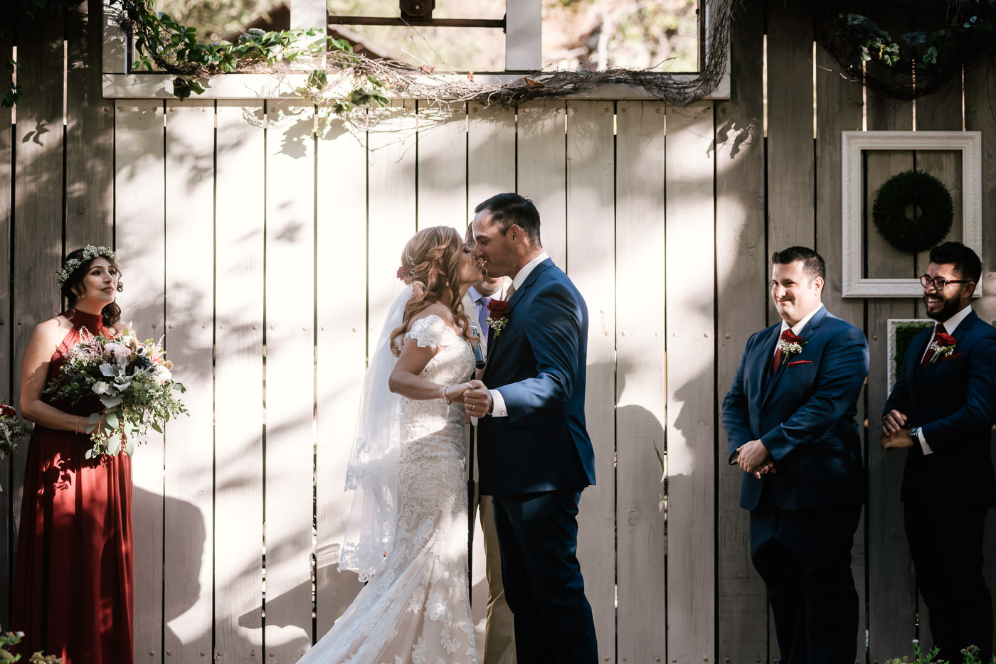 Couple leans in for their first kiss as husband and wife.