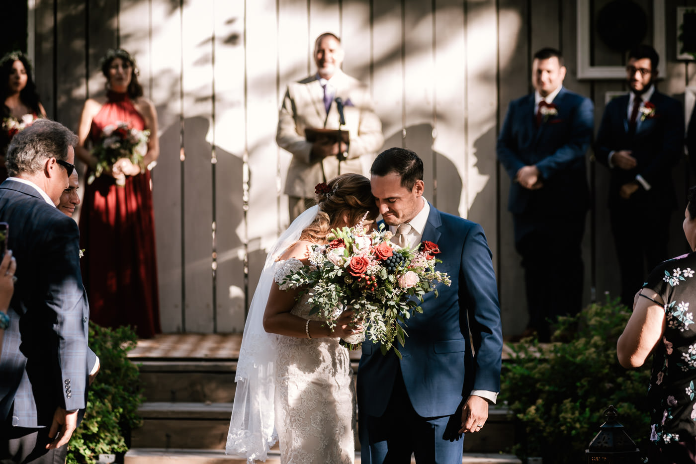 Couple takes a moment to get cloe and savor this sweet moment after pledging their lives together.