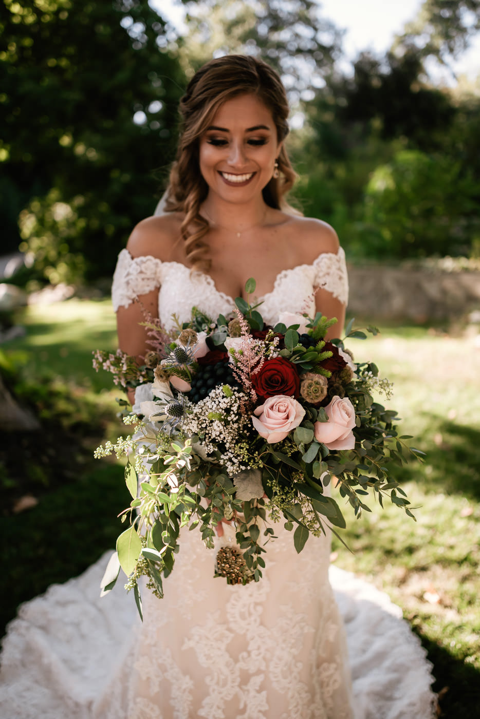 Stunning bride shows off her gorgeous bouquet.