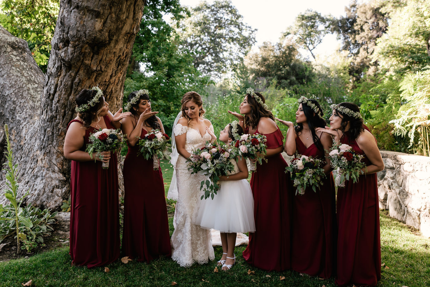 Bridesmaids blow a kiss to the beautiful bride.