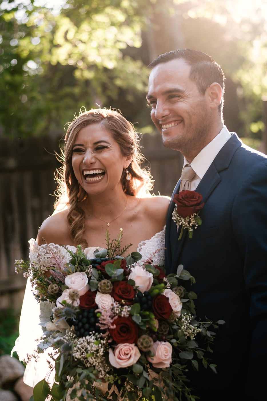 Couple laughs and has a blast while doing their wedding photos.