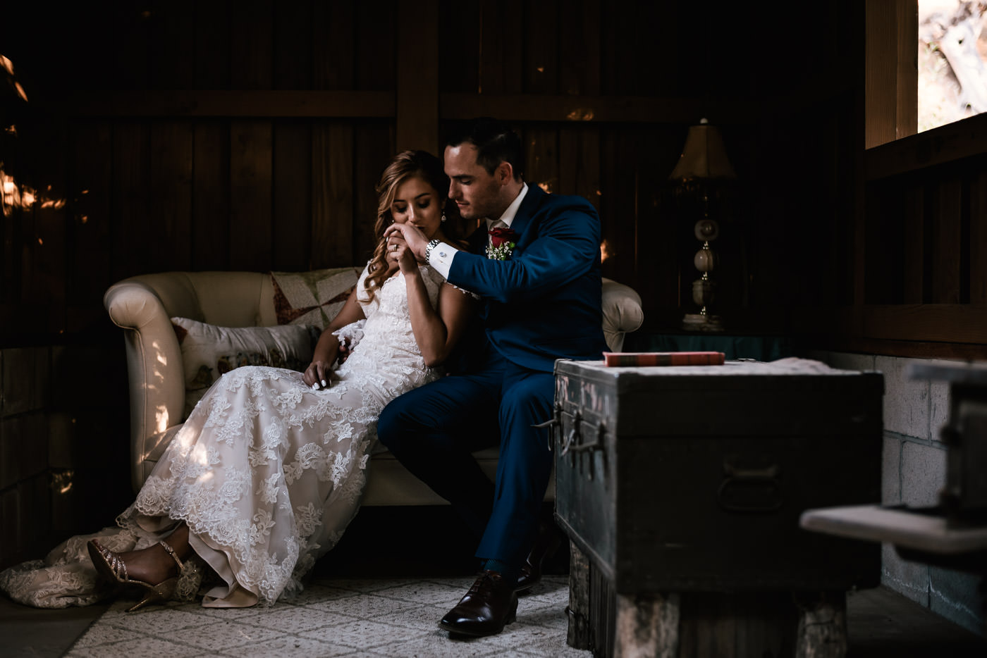 Romantic moment between a newly married couple captured at The Homestead.