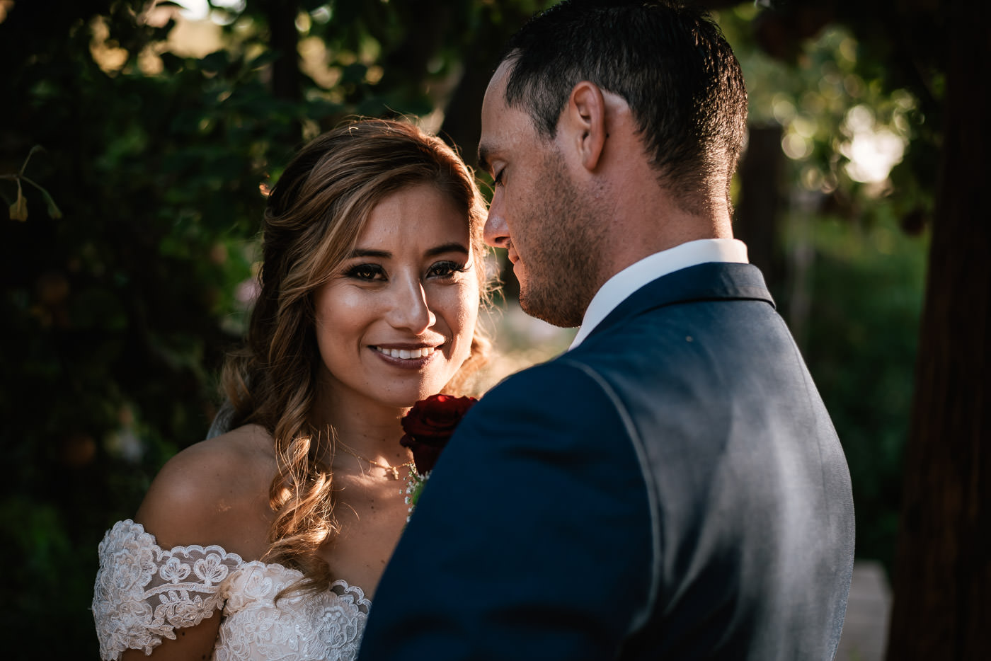 Newly married bride smiles with happiness after her rustic wedding at The Homestead at Wilshire Ranch.