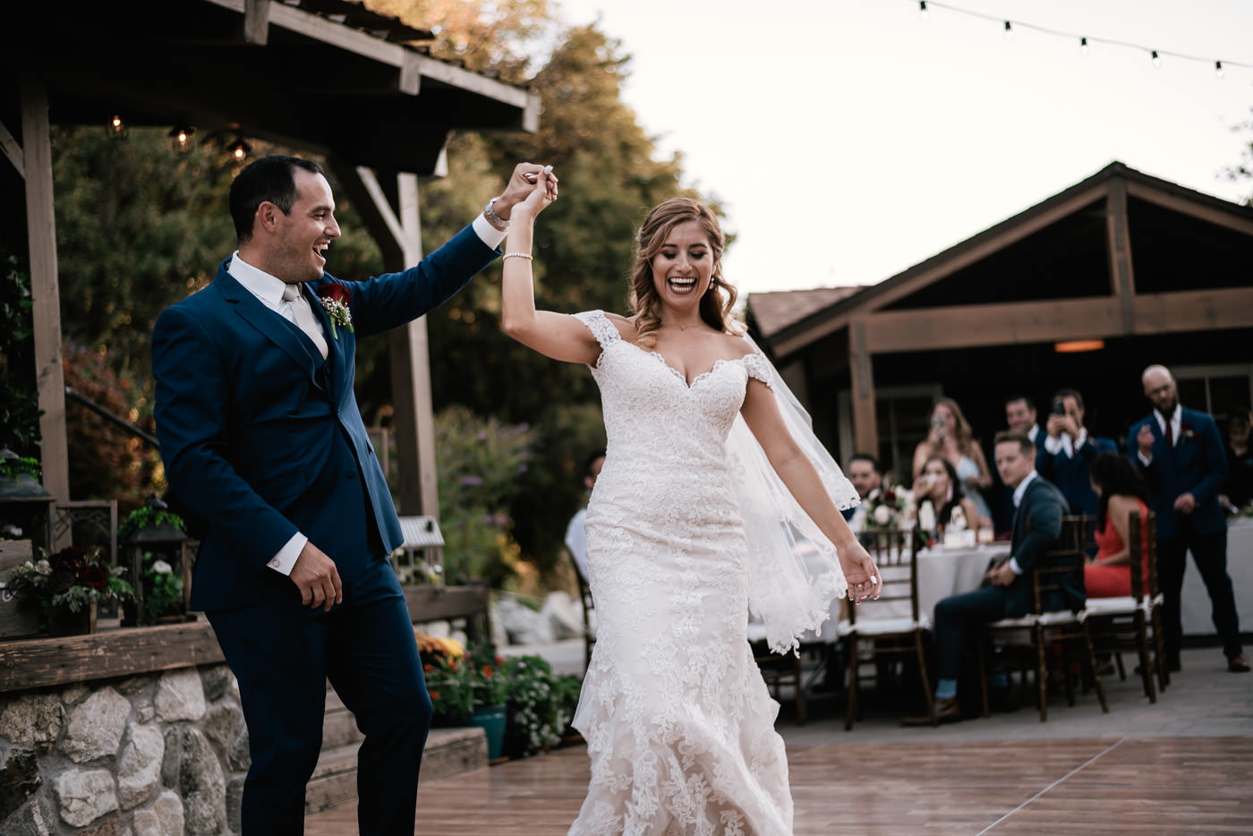 Every first dance should be filled with smiles and laughter like this.