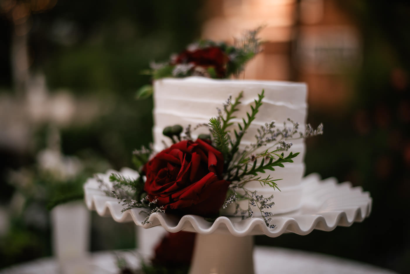 Beautiful rose topped cake at this wedding reception at The Homestead at Wilshire Ranch.