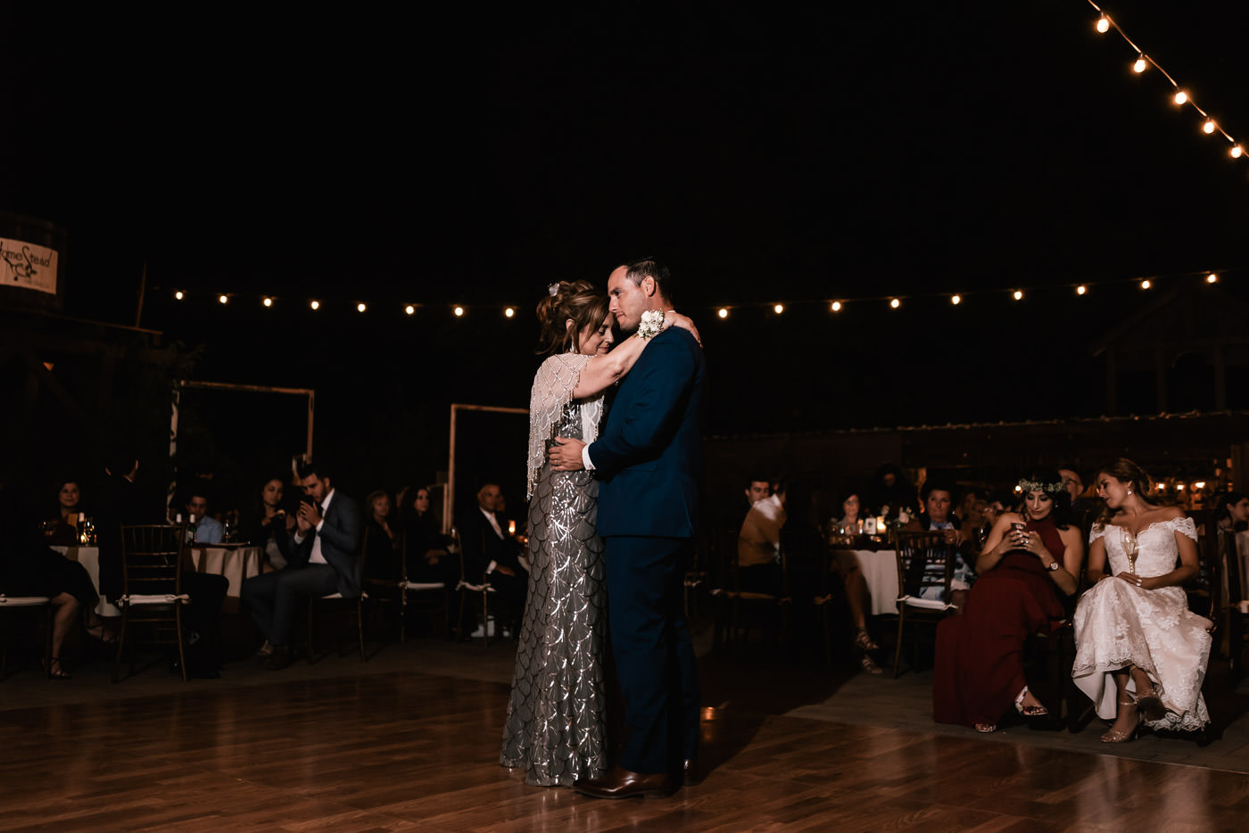 Mother and son have a lovely dance at the reception.