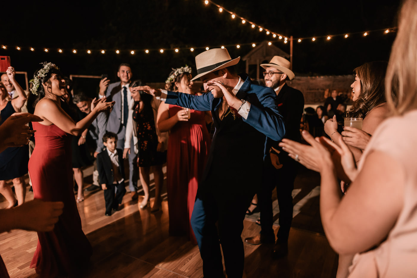 Groom puts on a fedora and tears up the dance floor.