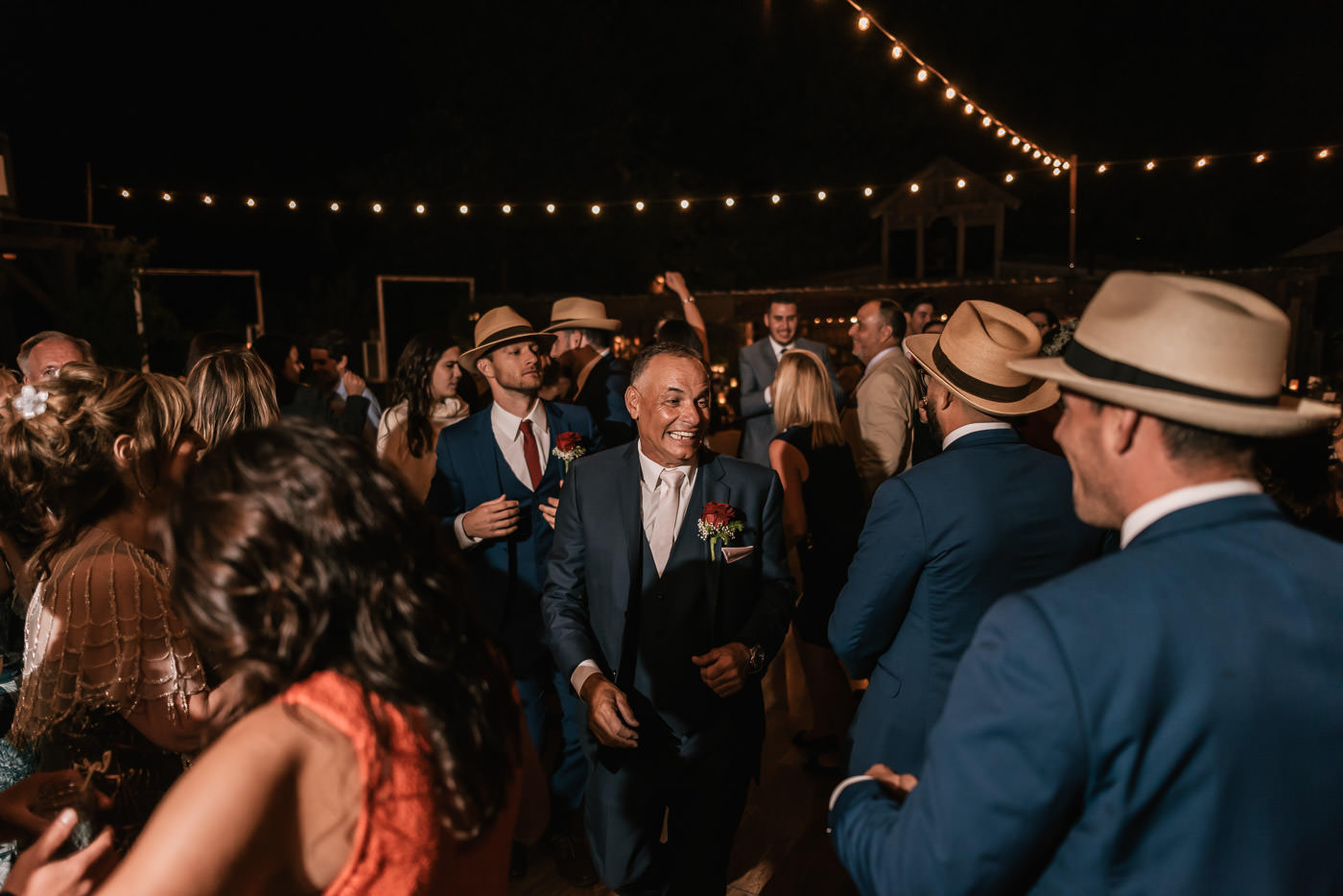 Father of the groom finds his son on the dance floor at The Homestead.