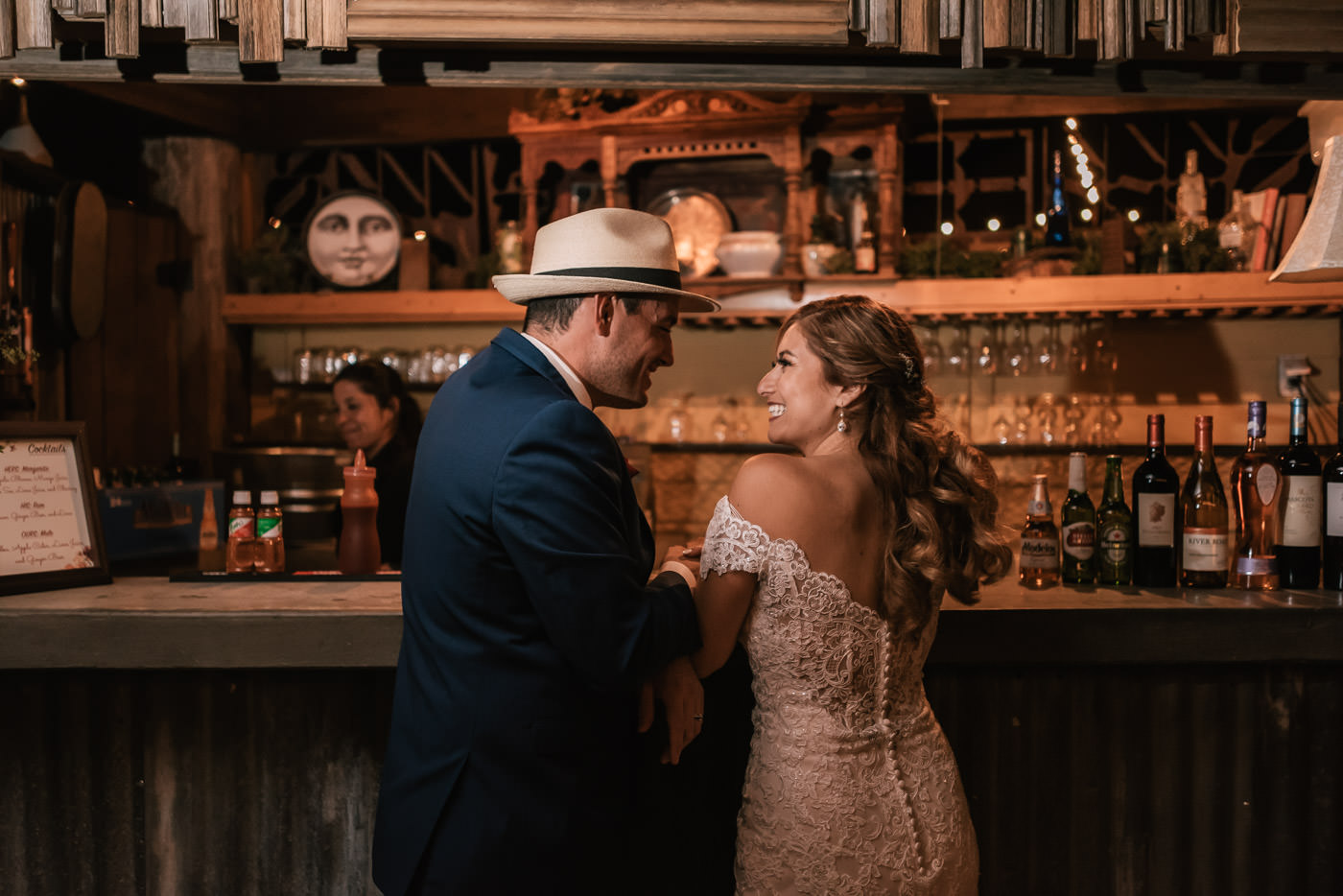 Newlyweds hit the bar and order their favorite drinks.