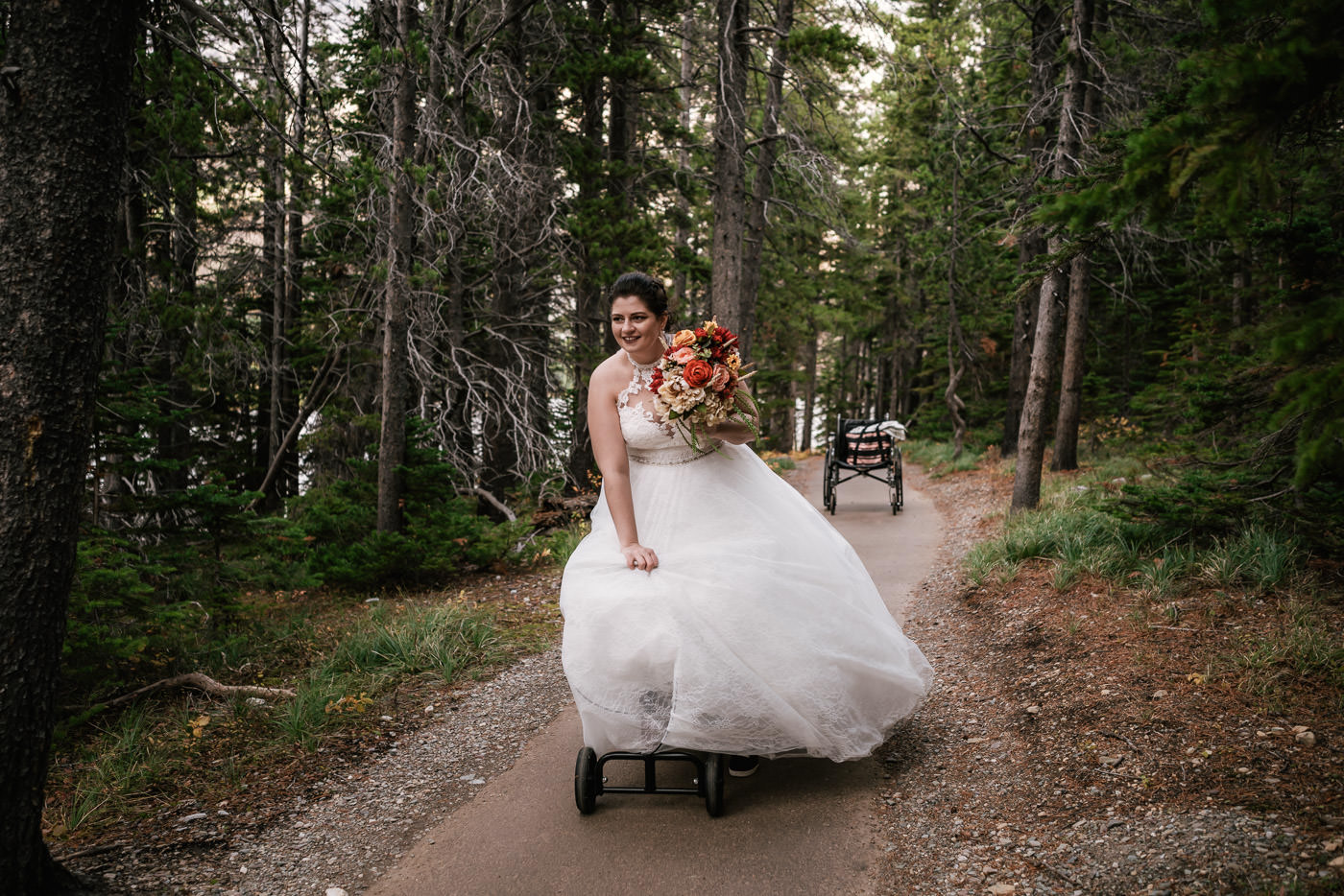 Bride walks herself down the aisle at her Glacier elopement despite having a broken leg.