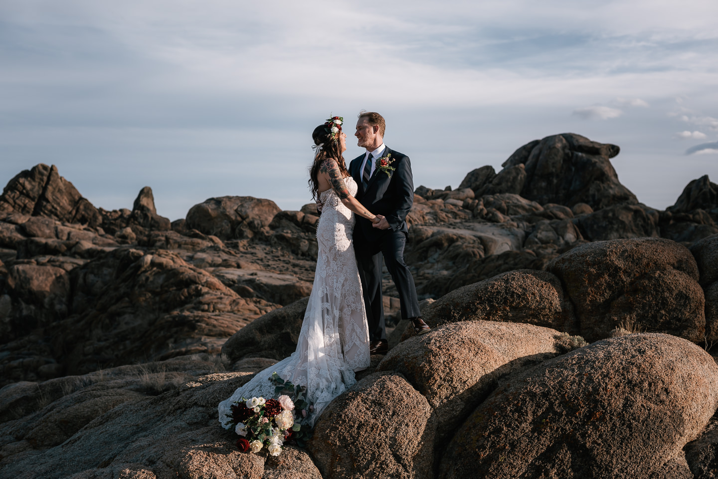 A love story to remember - This was my first elopement of 2019 and what a way to kick off my busiest year yet. These two made their elopement one I'll never forget. With a few simple touches, a copper pipe arch, a white faux fur rug, and floral details their intimate wedding ceremony in the Alabama Hills was transformed into a thing of refined beauty. But the real star of the day was the couple themselves. Be it their uncanny ability to make each other laugh, the way they made one another smile, or their heartfelt vows, these two were a pristine example of true love. But I hardly need to say anything as it will be painfully obvious from the photos below.