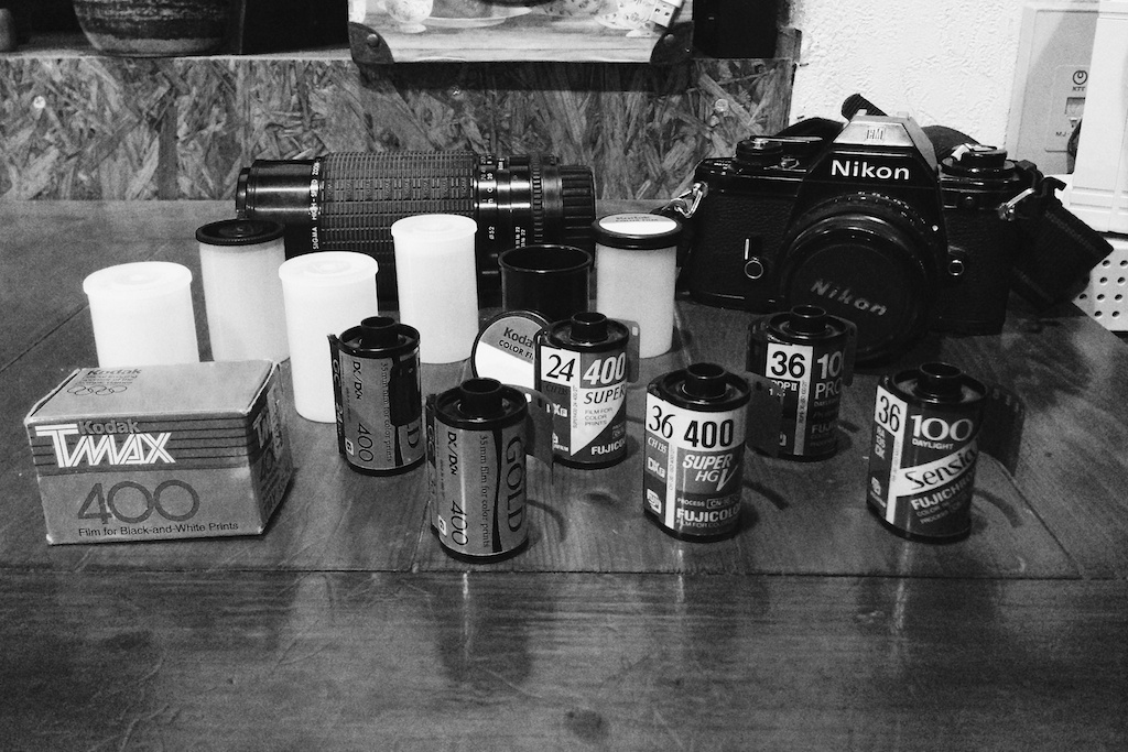 Some of the film set up next to the Nikon EM. One of the two 35mm SLR's I'll be shooting.