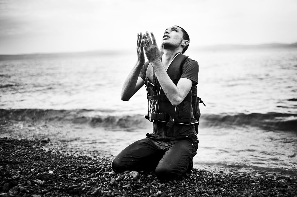 A young man falls to his knees on the beach. It's September 9th 2015 and he's thanking the higher powers that he has survived the rubberboat crossing from Turkey to Greece. Other refugees hug while cheering and crying. A woman collapses from exhaustion while her child screams. Boat number 26 of the day has reached the shore at the small village of Skala Sikamineas on the Greek island Lesvos.The refugee crisis in Europe has been called the worst since the Second World War. 2015 was the year, where a large majority of Europeans for the first time realized just how serious the crises has become. According to the International Organization for Migration (IOM) hundreds of thousands of people have fled towards Northern Europe - almost half crossing the Aegean Sea and into Greece. Over the summer Lesvos became the main gate to the European Union, where local volunteers at the northern beach counted upwards of 60 boats a day filled to the brim with men, woman and children of all ages.
