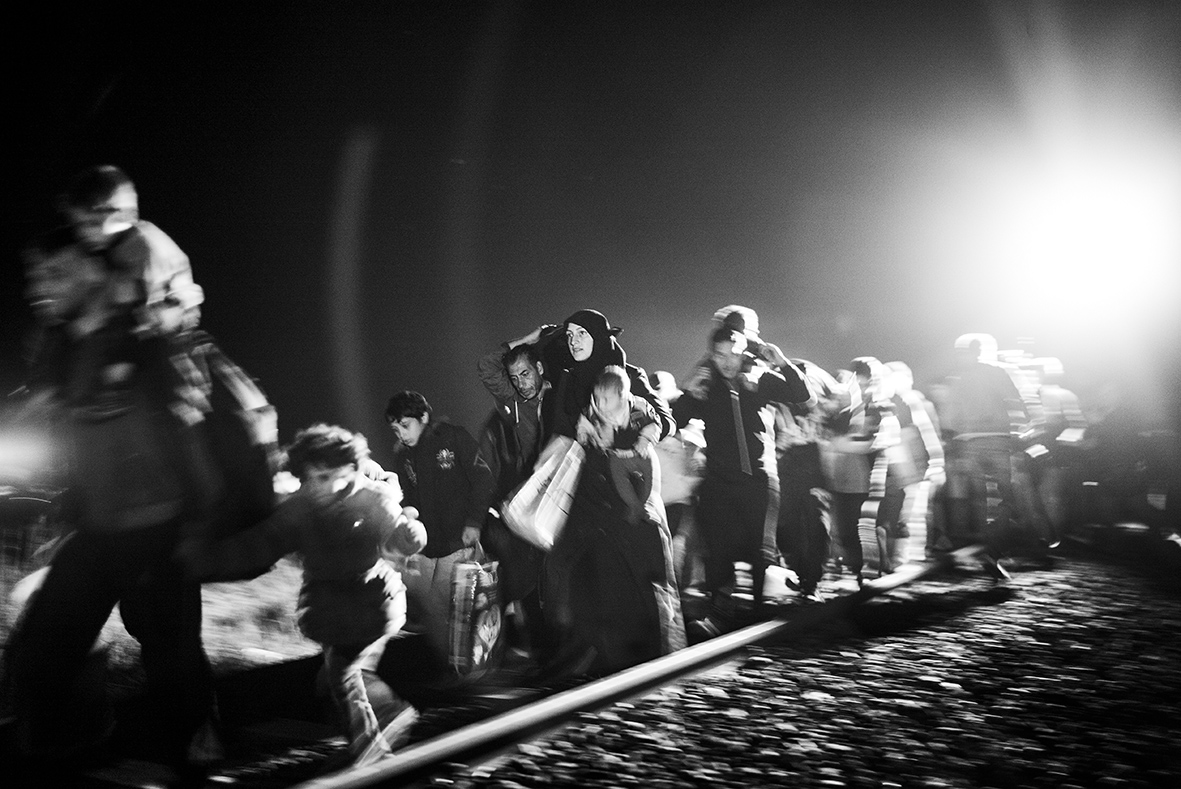 A group of refugees are trying to escape the Hungarian police near the border town Röszke on the 12th of September 2015 in an effort to avoid registration. The number of refugees coming to Europe in 2015 reached one million in December according to the International Organization for Migration. And while the European politician are yet to find a solution for the crisis, more people are traveling north - each and everyone of them with hopes and dreams of a new life and a better future.