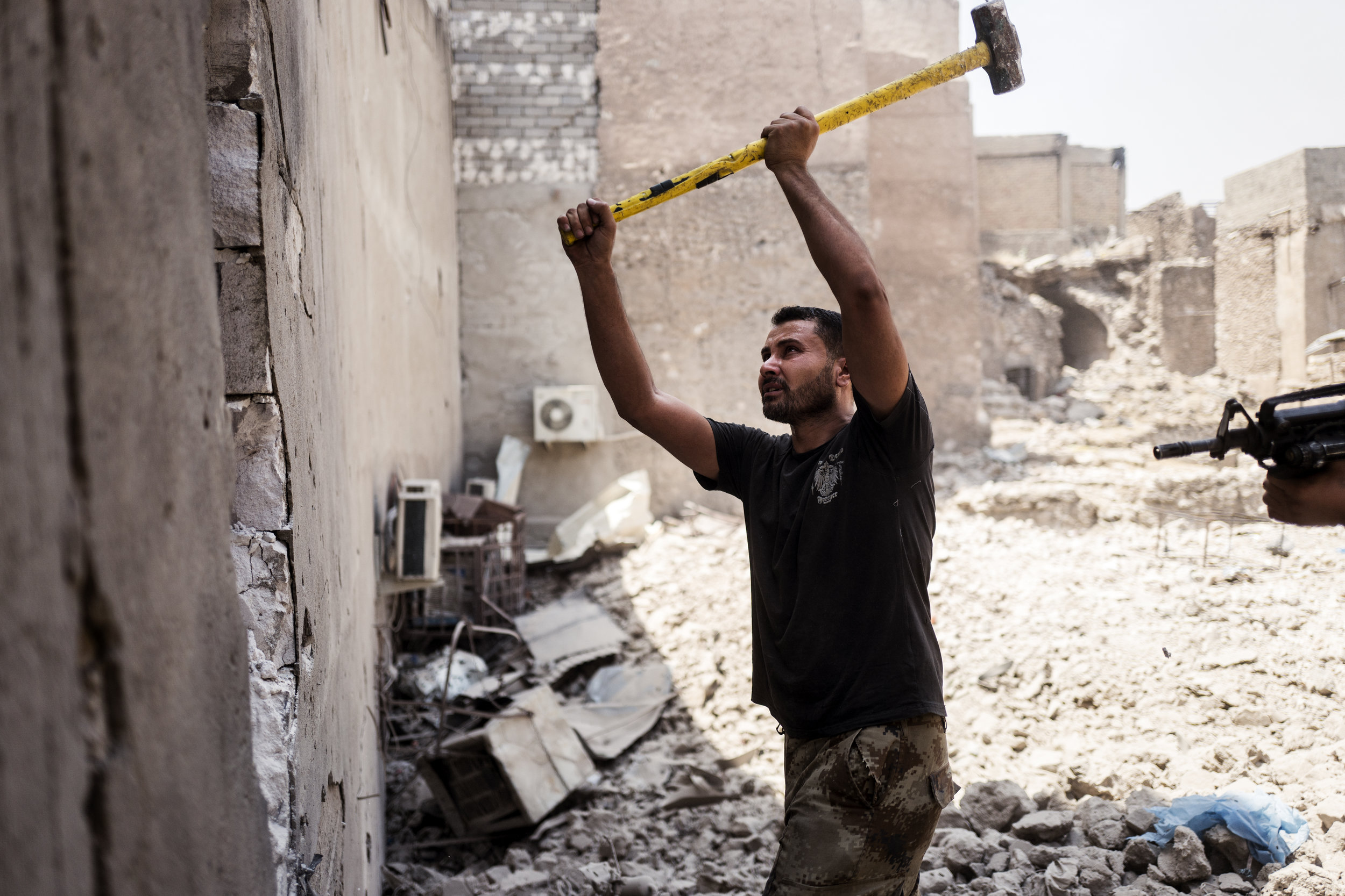 One of the many tactics used to clear the city was going from building to building through holes in the walls to avoid getting exposed to enemy fire.