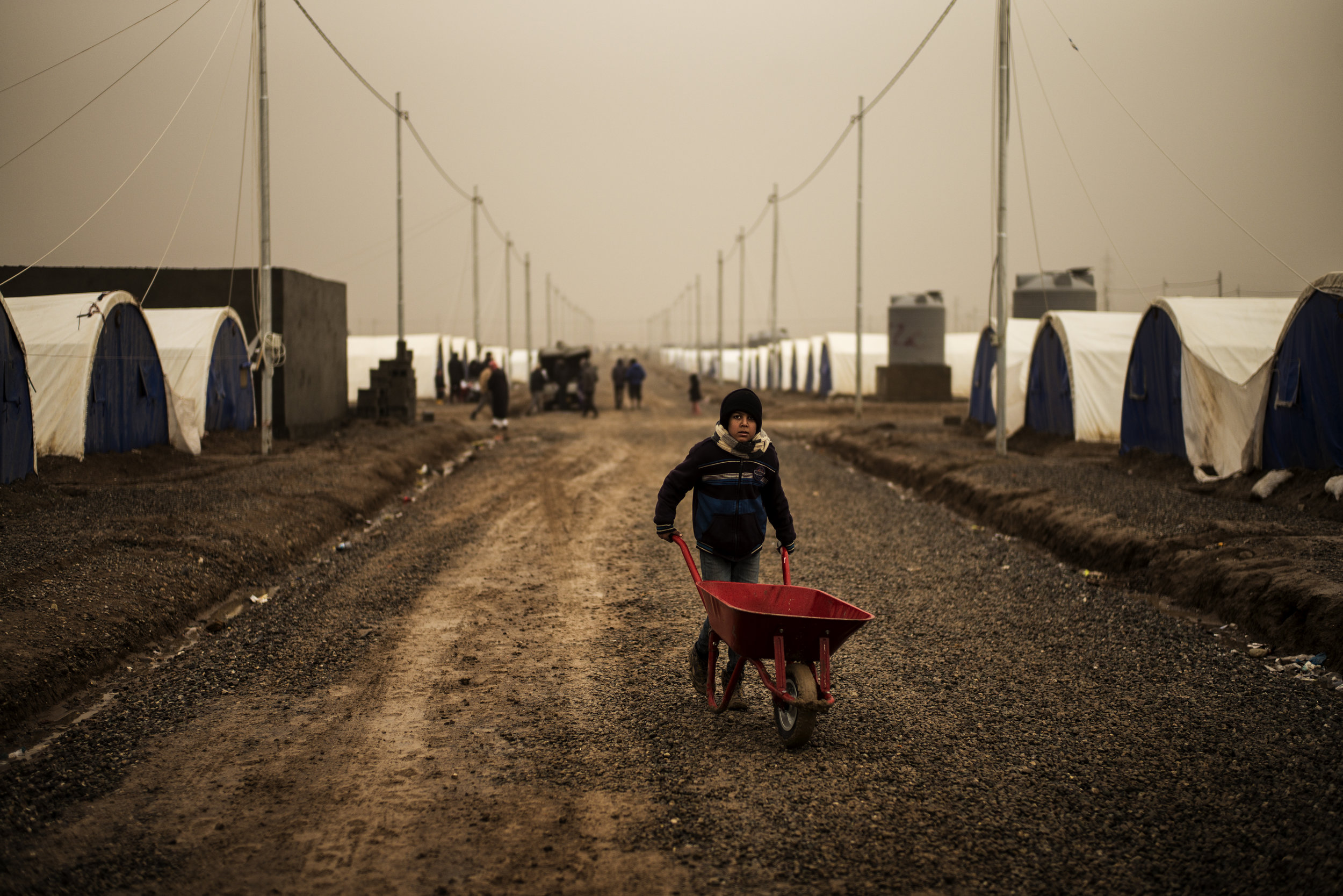 A boy going after water for his family at the Khazer IDP-camp near Mosul.