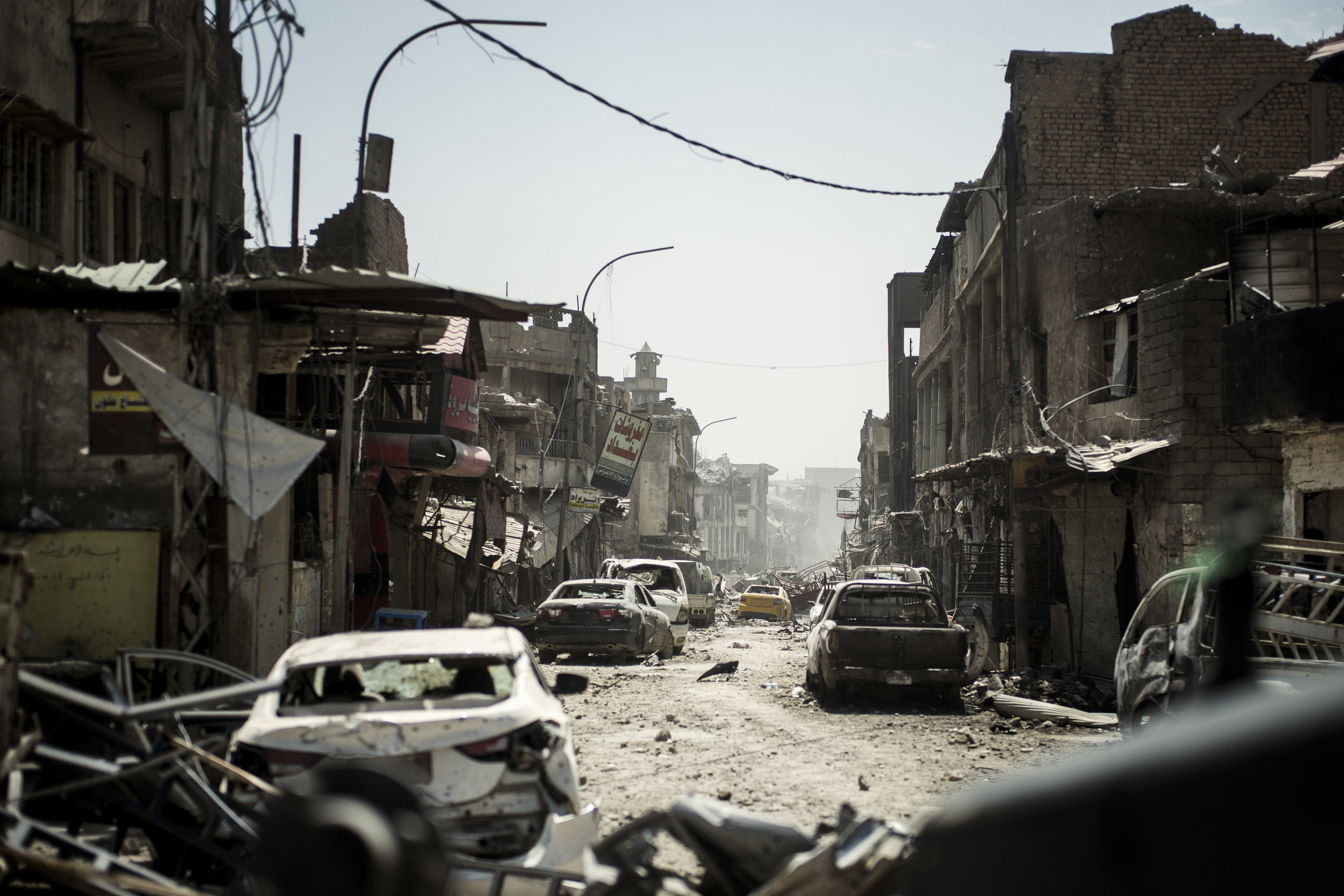 'They're right behind the yellow car', the soldier says while pointing down the street. 120 meters away ISIS and special forces units exchanges fire. The ISIS occupation of Mosul has almost reached it's end. A few hours earlier Golden Division retook the Al-Nuri Mosque, where ISIS leader Abu Bakr al-Baghadadi proclaimed the caliphate. Now the Iraqi forces are fighting to retake the last occupied areas of the city.