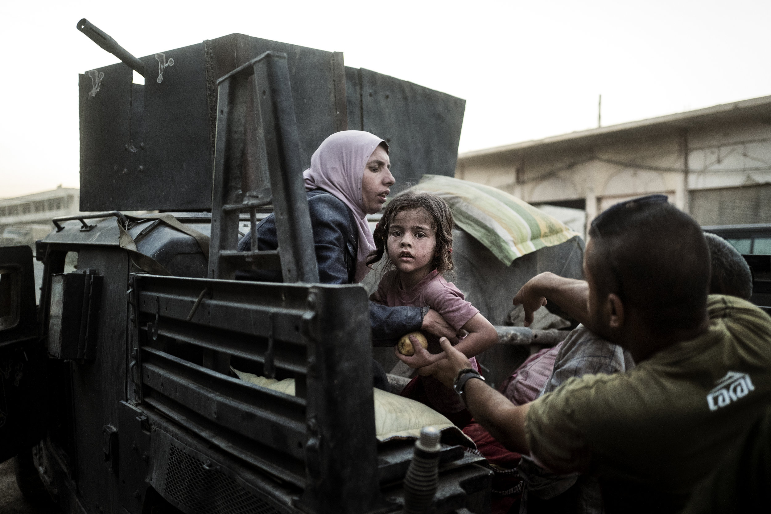 When they are not occupied with fighting ISIS the Iraqi soldiers try to help the many civilians trapped inside Mosul by driving them to the safe parts of the city.