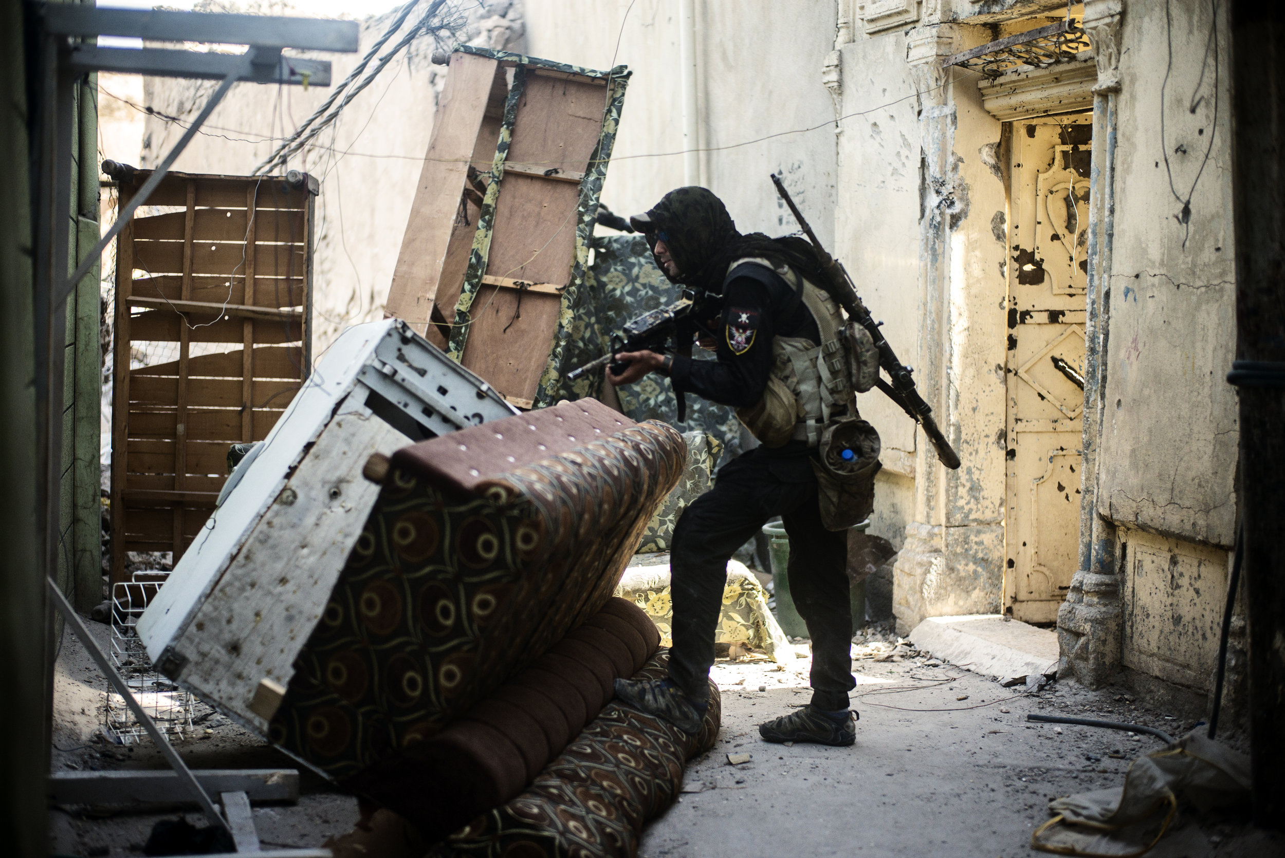 Iraqi sniper standing guard near general Salam Husseins forward operating headquarters.