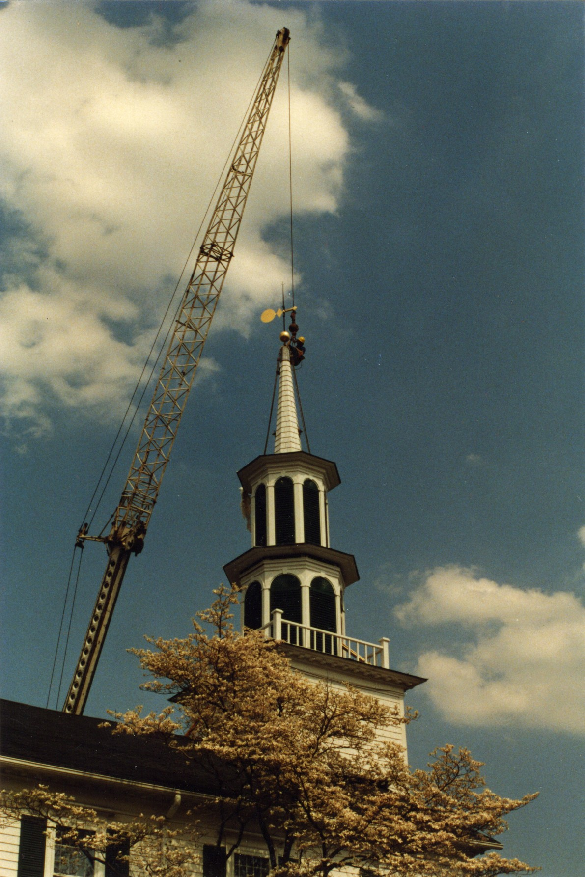 A two cupola steeple with spire atop narthex..
