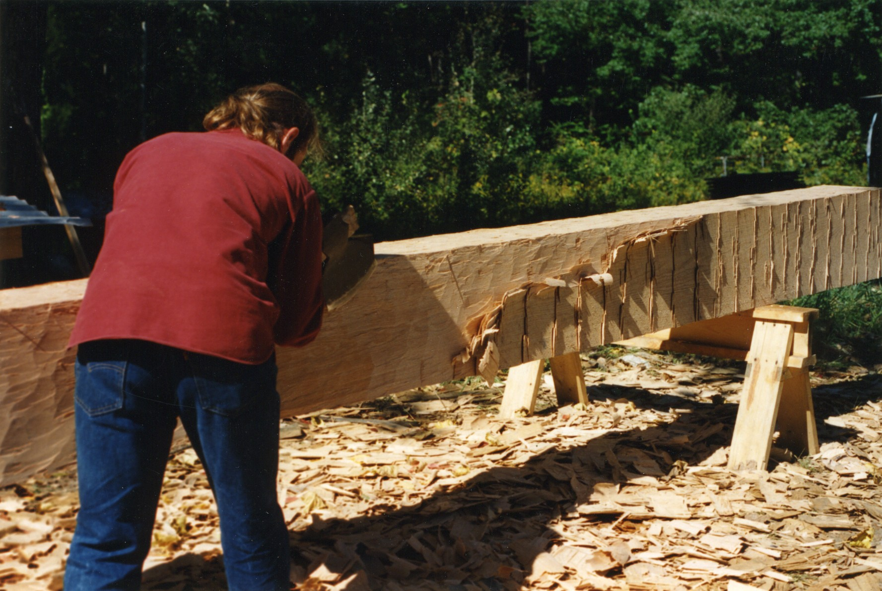 Hand hewing with a broad axe