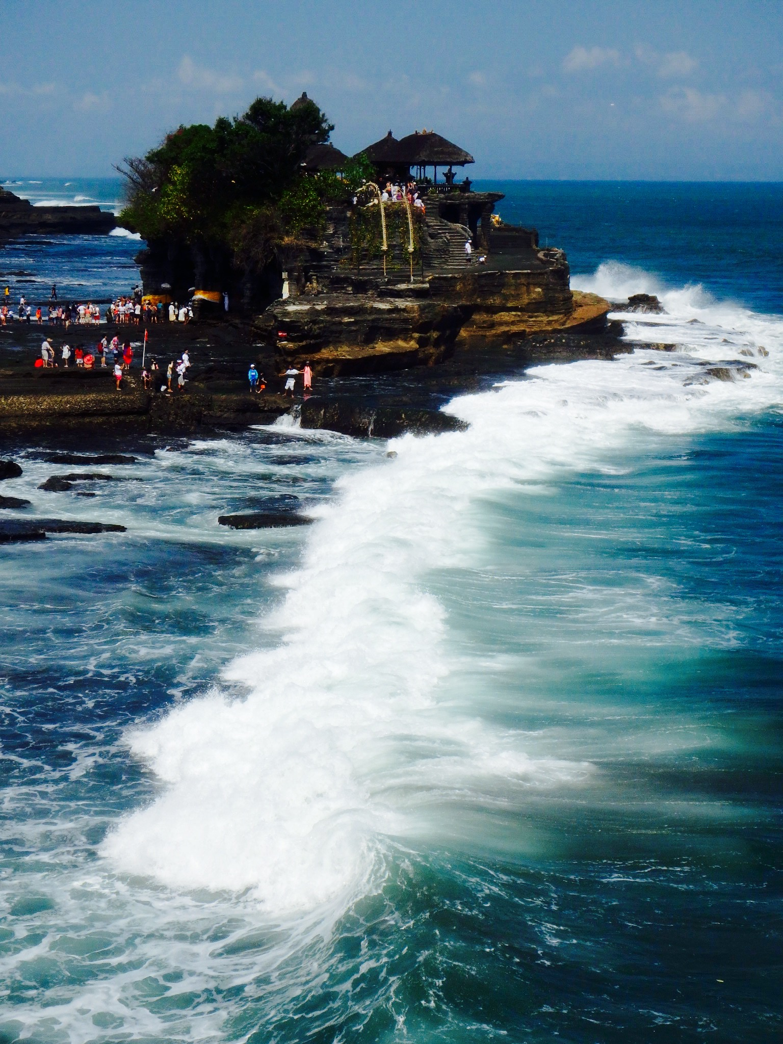 Holy Snakes and a rough surf keep the Tanah Lot Temple free of evil spirits.