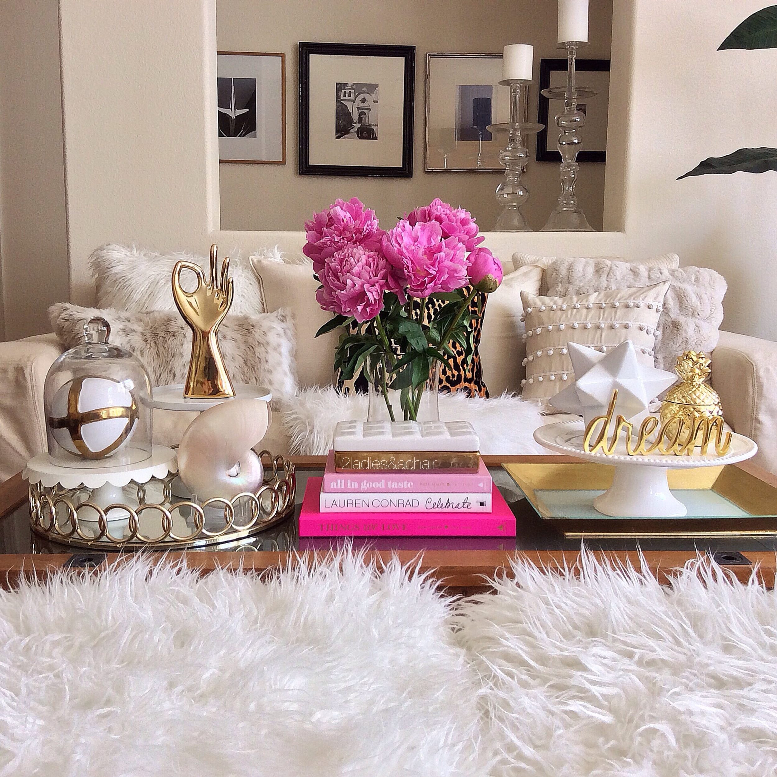Here my sofa is all done in creams and white. I couldn't resist adding these beautiful pink peonies (and pink books) to this colorless setting.