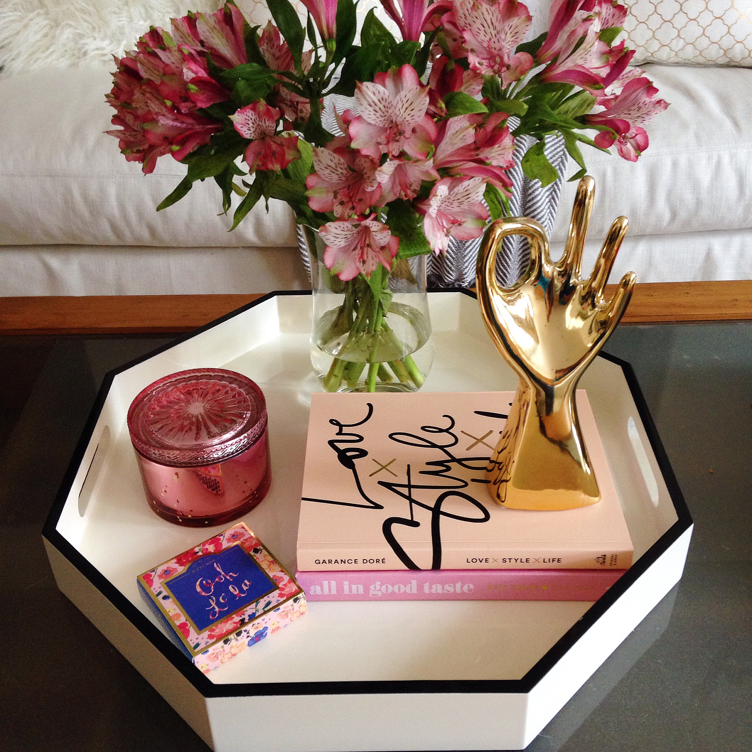 Another great way to add color is by grouping colorful decor items in trays.