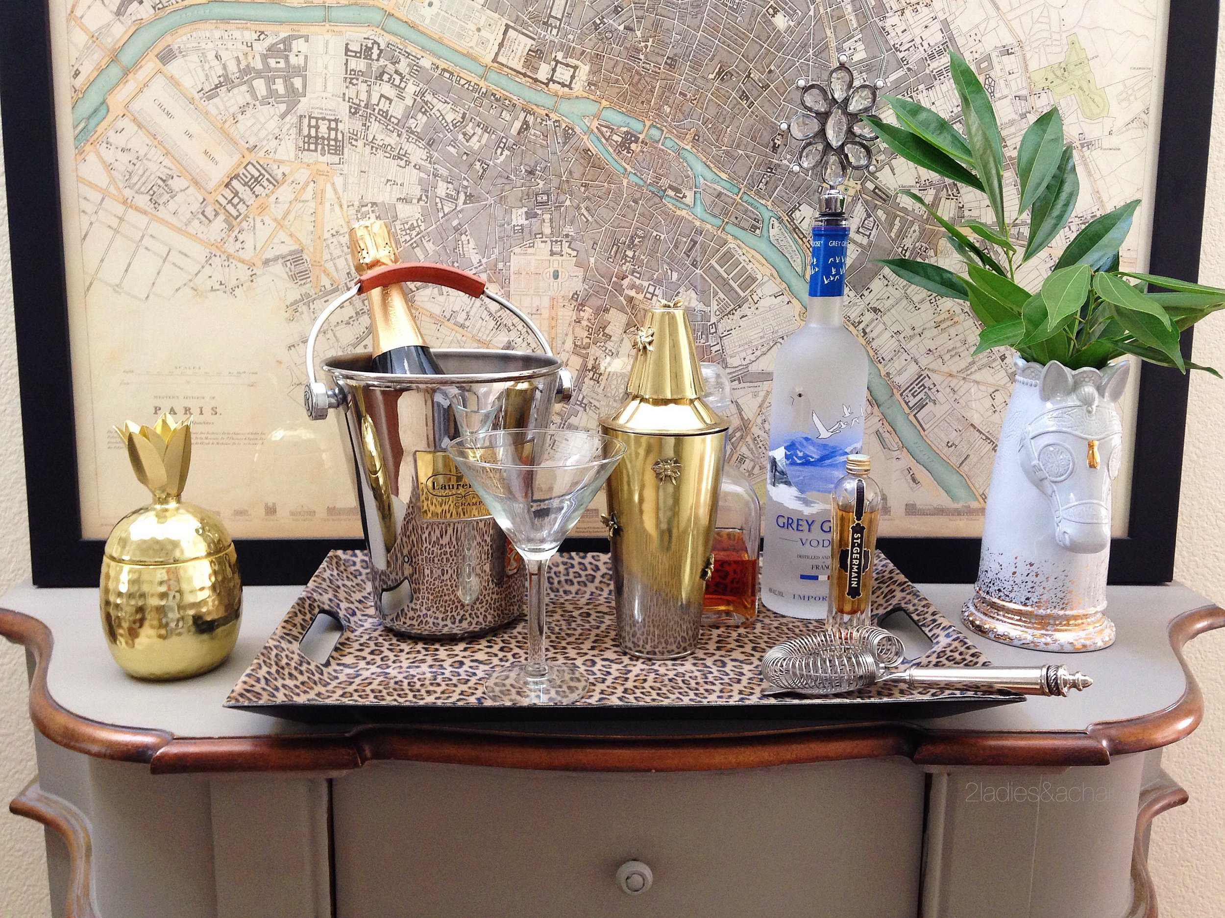 No bar cart, no problem. A tray on top a console table or chest of drawers is a perfect spot for a bar.