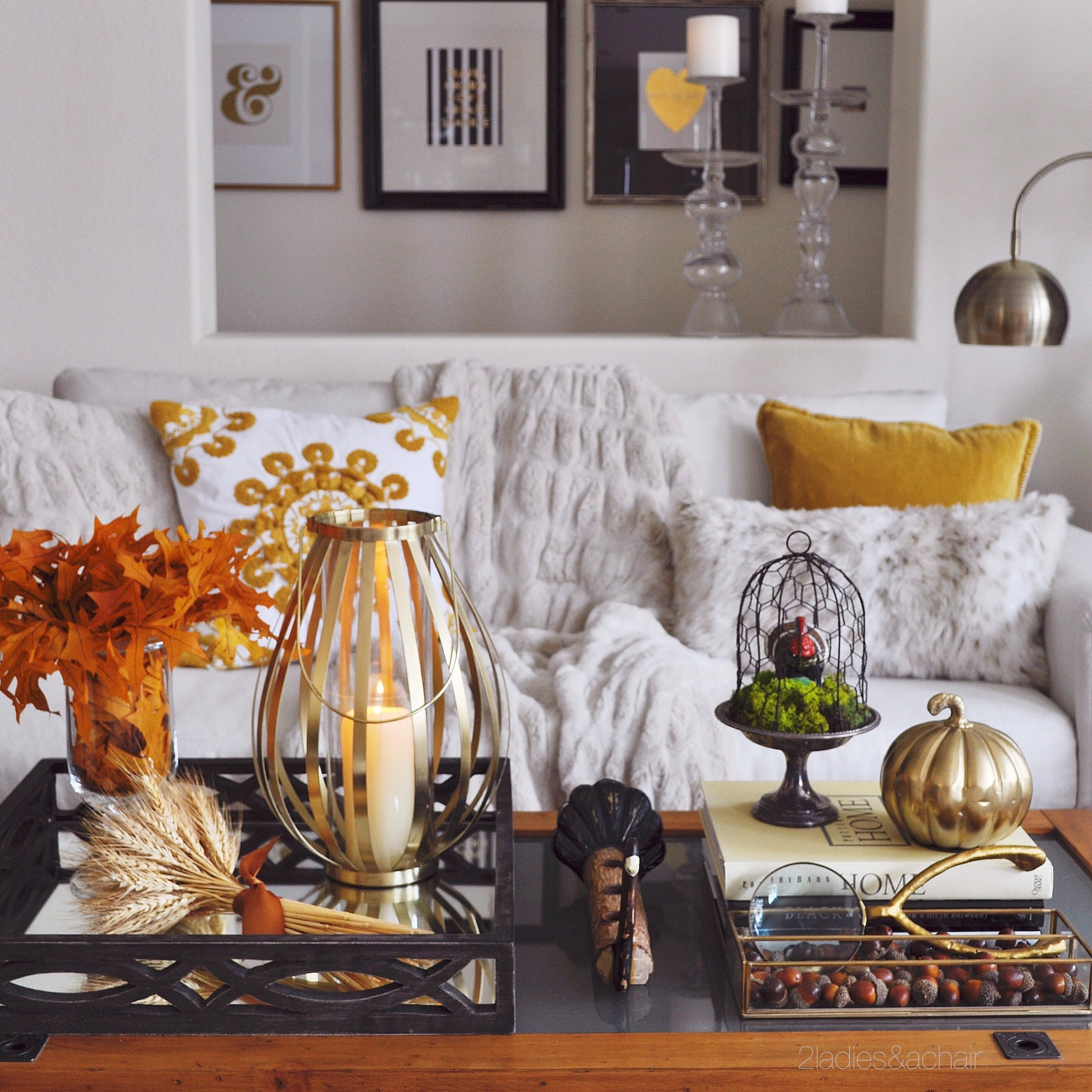 These gorgeous fall leaves and vase are the perfect accessories for this fall coffee table! I couldn't pass up this whimsical wishbone magnifying glass! All from HomeGoods.