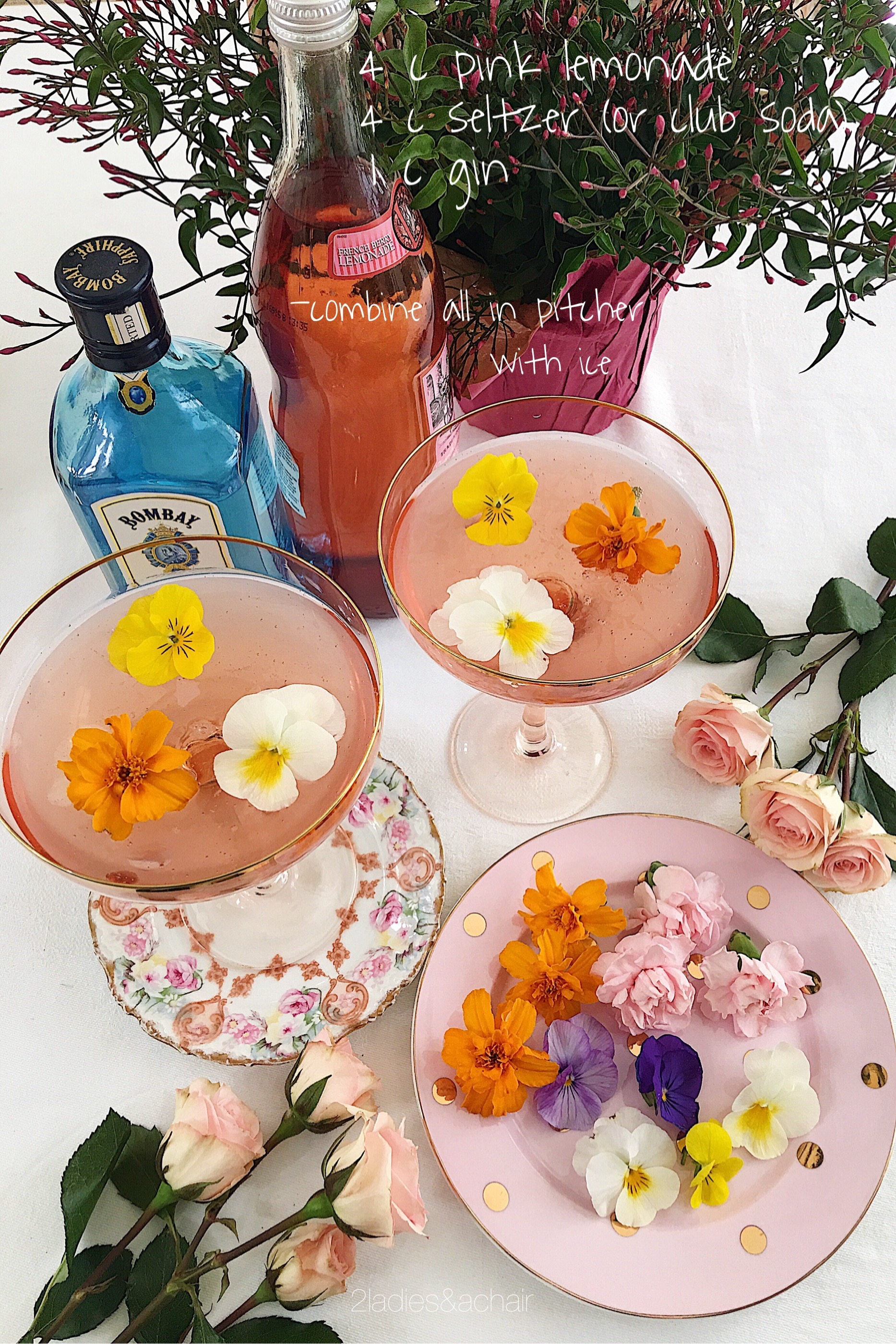 Edible, pesticide free flowers like violas, carnations, marigolds, and nasturtiums are pretty floating on top of punch bowl or individual glasses. Google for more edible flower choices. Add seltzer just before serving.