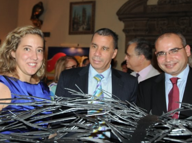 Caroline Bergonzi with Governor Paterson of NY (center) and guest.