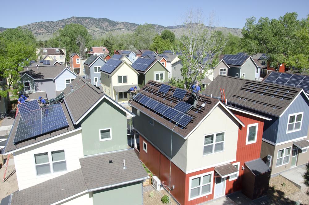 Solar installers on neighborhood solar project
