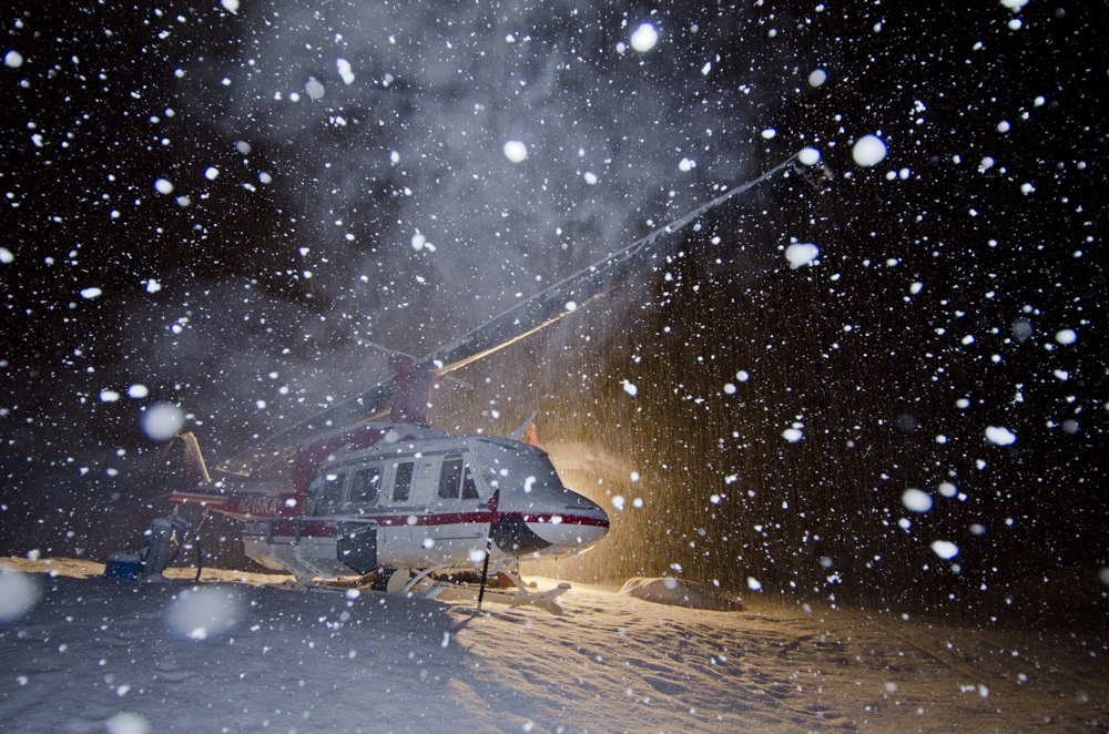 Heli-ski helicopter in heavy snowfall
