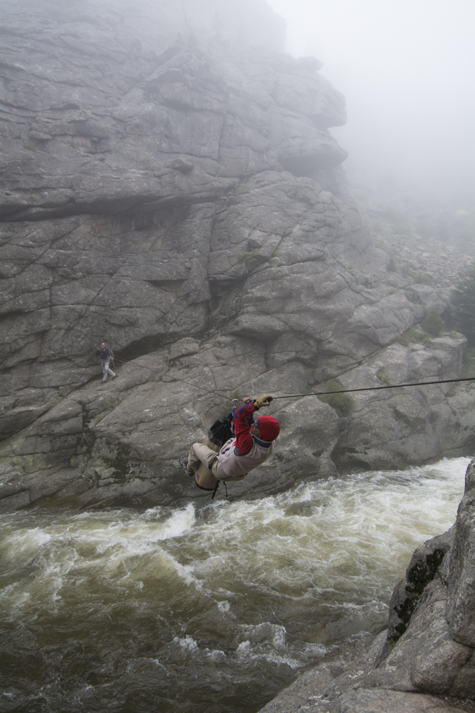 Crossing a tyrolean traverse in the Indian Peaks.