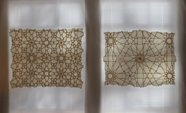 """Shadowfold Zillij Dodecagrams"" (2010) and ""Shadowfold Zillij Octagrams"" (1997), folded and pleated silk, uncut and undyed, by Chris Palmer."