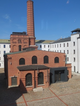 "Photo taken from one of 4 wings of the Centralne Muzeum Włókiennictwa (Central Museum of Textiles), Lodz, formerly ""The White Factory,"" erected by the family of Ludwik Geyer in 1835–1886. Site of the International Triennale of Tapestry."