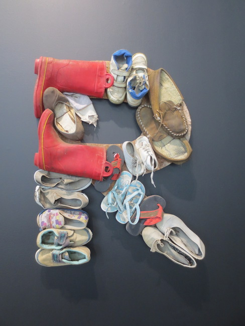 Untitled R  (1990), by George Herms. Assorted shoes, plywood, wire. Gatehouse Gallery.
