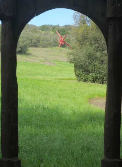 Looking through arch of one sculpture toward  For Veronica  (1987), by Mark di Suvero. Steel, paint. Created for Veronica di Rosa.