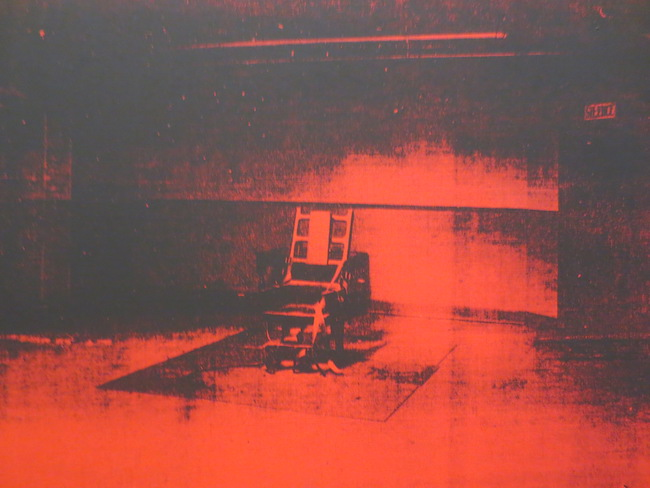 "Detail of ""Red Disaster"" (1963), by Andy Warhol. Silkscreen ink on synthetic polymer paint on canvas. Museum of Fine Arts, Boston. Derived from a photograph of the electric chairs in Sing Sing Penitentiary in Ossining, New York, where alleged Soviet spies Julius and Ethel Rosenberg were executed on 13 January 1953, at the height of the Cold War."