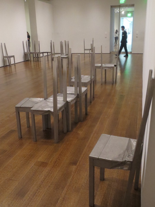 """Thou-less"" (2001-2002), by Doris Salcedo. carved, stainless steel chairs. Harvard Art Museums, Cambridge, MA."