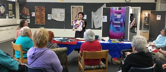 Youngmin Lee demonstrating  bojagi  at Sacramento Fine Arts Center. Photo courtesy of Sangho Lee.
