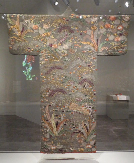 Robe ( kosode ) with landscape and literary designs ( goshodoki ), approx. 1800-1850. Japan. Silk crepe ( chirimen ) with embroidery. Asian Art Museum, San Francisco.