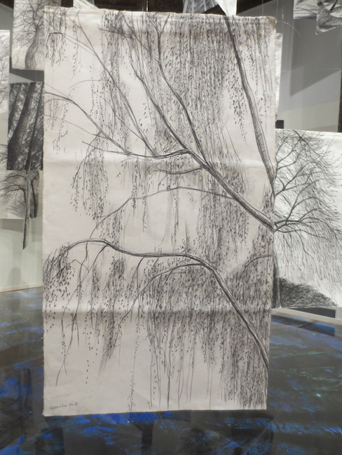 """Charcoal drawing in """"Chorus of Trees"""" (1917), by Younhee Paik."""